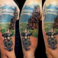 Beautiful biker and landscape tattoo on half sleeve