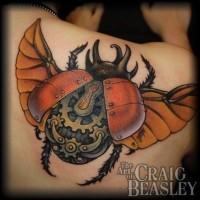 Beautiful colored biomechanical bug  tattoo on shoulder blade by Craig Beasley