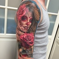 Beautiful colored shoulder tattoo of Mexican like woman portrait with flowers