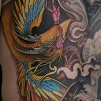 Beautiful colorful phoenix tattoo by Johan Finne