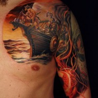 Beautiful colorful vikings on boat tattoo on shoulder
