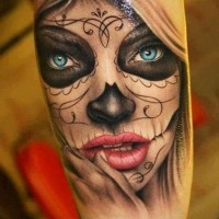 Beautiful day of the dead with blue eyes tattoo