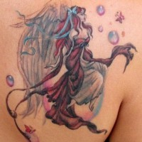 Beautiful fairy tattoo in color on shoulder blade