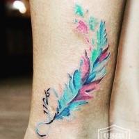 Beautiful illustrative style leg tattoo of feather