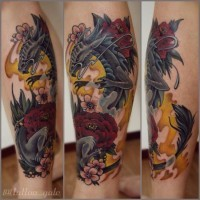 Beautiful looking colored dragon tattoo on leg with various flowers