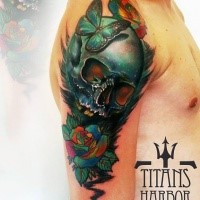 Beautiful looking colored shoulder tattoo of human skull with flowers and butterfly