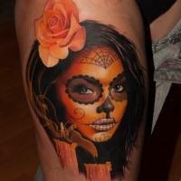 Beautiful looking colored thigh tattoo of Mexican woman portrait with flower and candles
