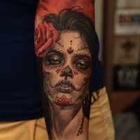 Beautiful men's muerte girl with rose tattoo on forearm