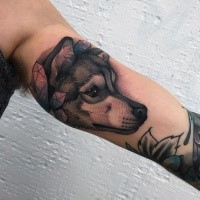 Beautiful modern style biceps tattoo of cute wolf with crystals