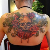Beautiful multicolored upper back tattoo of human skull and flowers