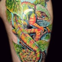 Beautiful natural looking thigh tattoo of big chameleon