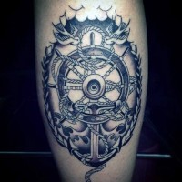 Beautiful nautical style black and white ship steering wheel with anchor tattoo on thigh