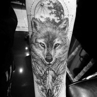 Beautiful nice looking forearm tattoo of animal skull with fox and moon