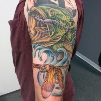 Beautiful painted and colored detailed hooked shoulder tattoo with dragonfly
