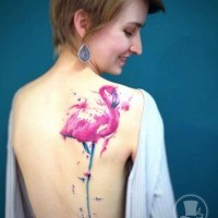 Beautiful painted big colored flamingo tattoo on back