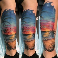 Beautiful painted colorful ocean beach with palm trees tattoo on leg