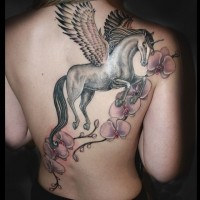 Beautiful painted very detailed flowers tattoo on back combined with unicorn