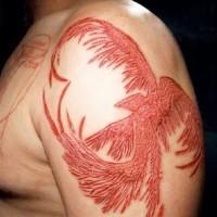 bellissima fenice scarificazione pelle sulla spalla