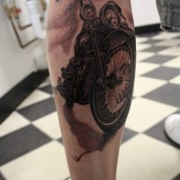Beautiful realistic biker tattoo on leg