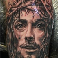 Beautiful realistic jesus crowned with thorns tattoo on arm