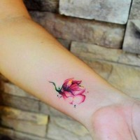 Beautiful watercolor flower tattoo on wrist