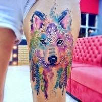 Beautiful watercolor style thigh tattoo of wolf with feather and ornaments