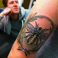 Bee tattoo on arm by Bobby Johnson