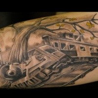 Biceps tattoo painted in black and white style of train crash