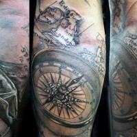 Big 3D like black ink nautical tattoo with map and compass on arm