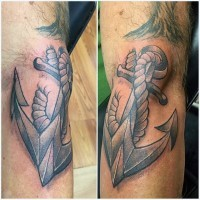 Big 3D like black ink roped anchor tattoo on arm