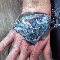 Big 3D like blue colored pure diamond tattoo on hand