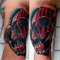 Big 3D style colored tribal skull tattoo on arm combined with feather