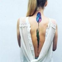 Big beautiful colored back tattoo of interesting flower