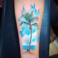 Big beautiful colored palm tree on ocean shore arm tattoo