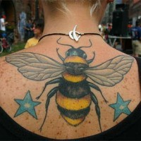 Big bee and two blue stars tattoo on back