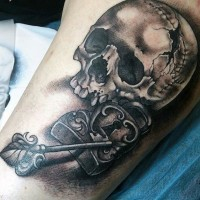 Big black and white corrupted skull with lock and key tattoo on arm