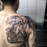 Big black and white shoulder tattoo of angel and kids