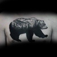 Big black ink chest tattoo of bear stylized with big forest