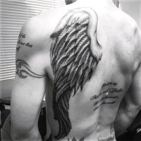 Big black ink detailed angel wing tattoo on back