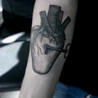 Big black ink lock shaped heart with key tattoo on arm