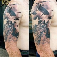 Big black ink modern military tattoo on area of shoulder