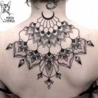 Big black ink upper back tattoo of flower shaped ornaments