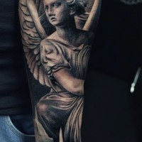 Big colored antic angel statue tattoo with candle