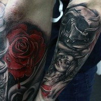 Big colored horrifying tattoo with skull and vampire woman on sleeve