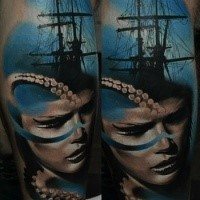Big colored leg tattoo of big ship with woman face and octopus
