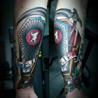 Big colorful coffin with lettering and tooth tattoo on wrist