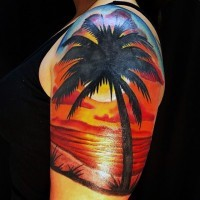 Big colorful romantic ocean sunset half sleeve tattoo with palm tree