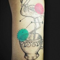 Big interesting designed flamingo in cup tattoo on arm combined with multicolored circles