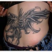 Big mythical dragon tattoo on lower back