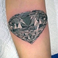 Big natural looking black and white diamond tattoo on arm